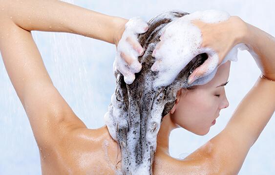 Beautiful hair model washing her hair 01