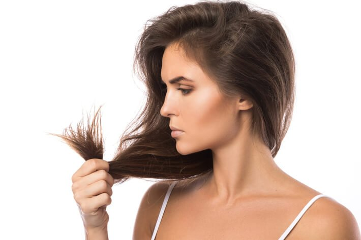 unhappy woman with damage hair